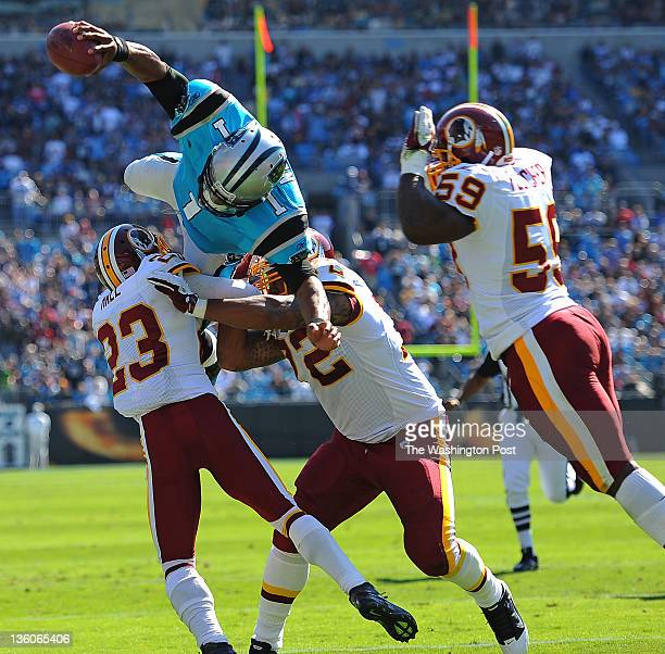 Carolina Panthers quarterback Cam Newton dives in the air as he tries to score a touchdown past Washington Redskins cornerback DeAngelo Hall...
