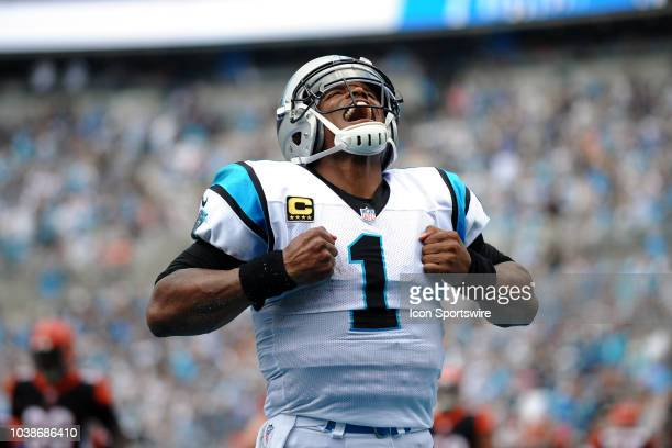 Carolina Panthers quarterback Cam Newton does his signature superman move after scoring a rushing touchdown during the NFL game between the...