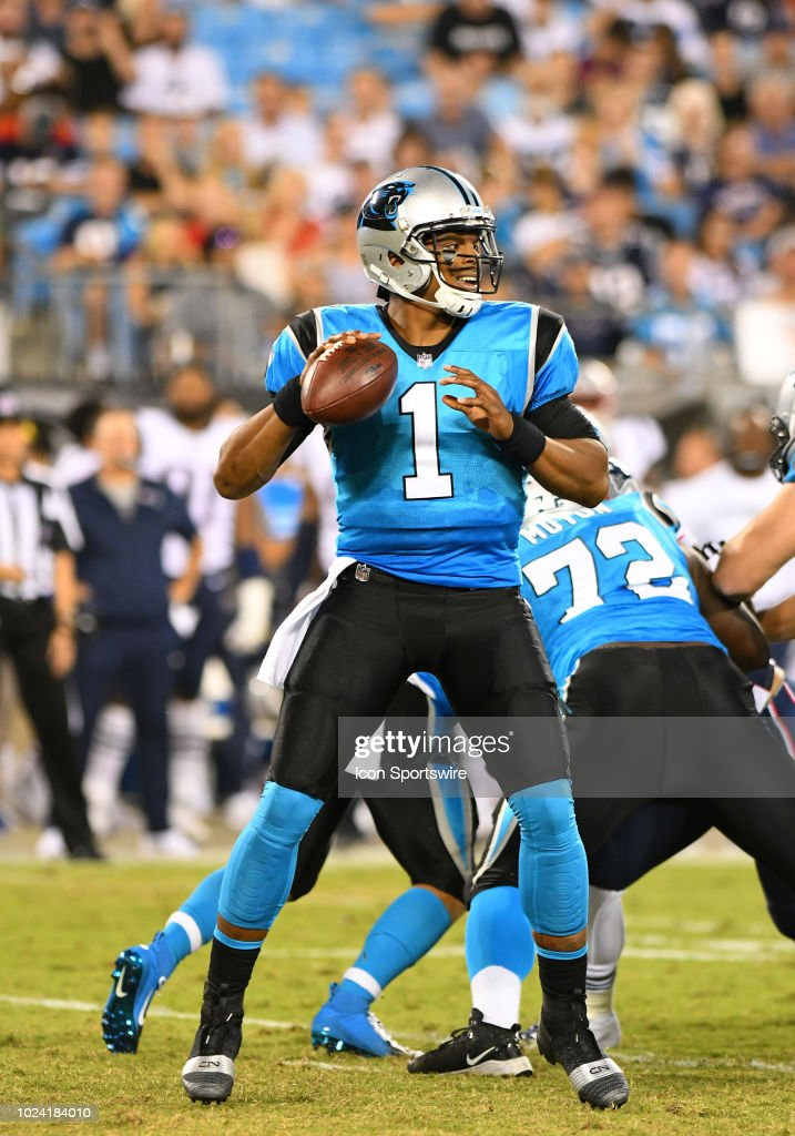 Carolina Panthers quarterback Cam Newton drops back to ...