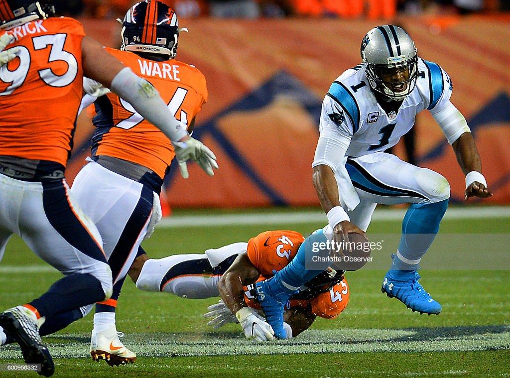 Carolina Panthers quarterback Cam Newton escapes the grasp ...