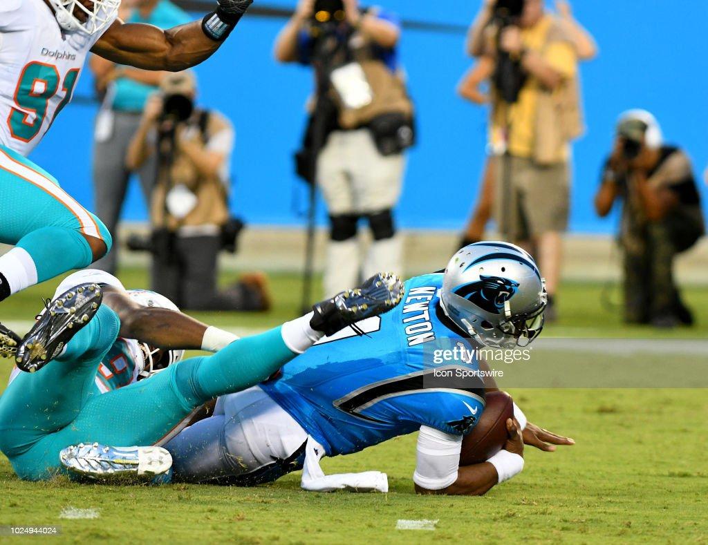 Carolina Panthers quarterback Cam Newton gets sacked on ...