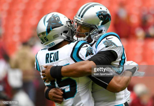 Carolina Panthers quarterback Cam Newton hugs strong safety Eric Reid prior to the game against the Washington Redskins on October 14 at FedEx Field...