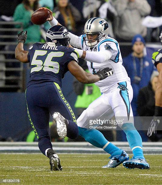 Carolina Panthers quarterback Cam Newton is pressured by the Seattle Seahawks' Cliff Avril in the first quarter in NFC Divisional Playoff action at...