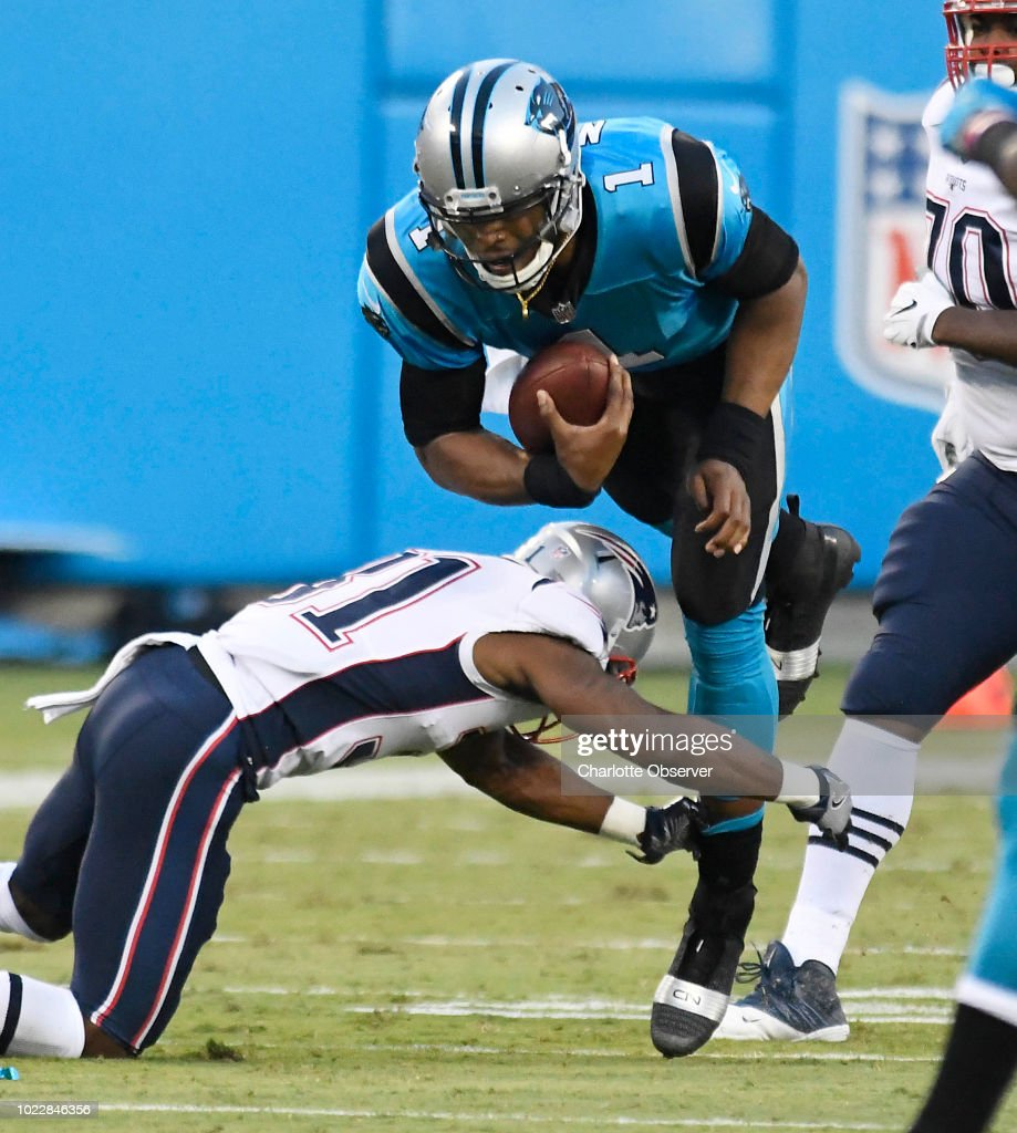Carolina Panthers quarterback Cam Newton is upended by New ...