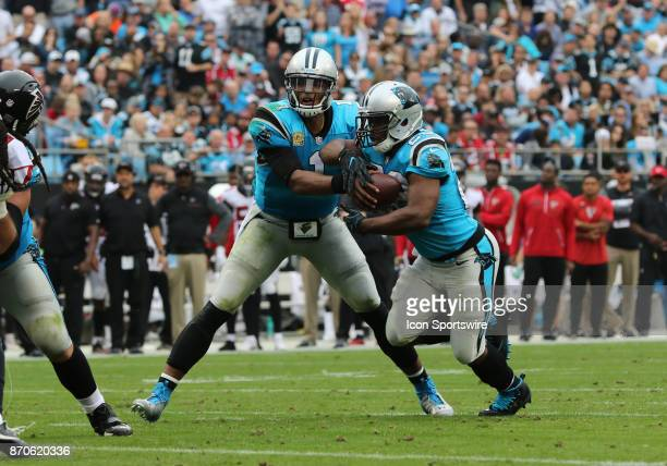 Carolina Panthers quarterback Cam Newton passes Carolina Panthers wide receiver Fred Ross the ball during 1st half of the Carolina Panthers versus...