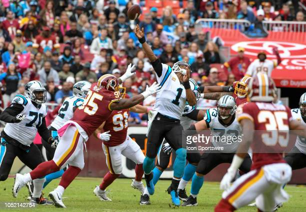 Carolina Panthers quarterback Cam Newton passes in the first half under pressure from Washington Redskins defensive tackle Da'Ron Payne in action on...