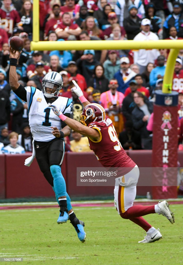 Carolina Panthers quarterback Cam Newton passes under ...