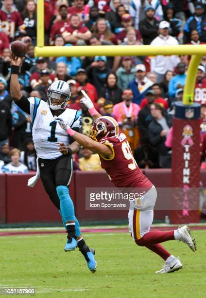 Carolina Panthers quarterback Cam Newton passes under pressure by Washington Redskins linebacker Ryan Kerrigan on October 14 at FedEx Field in...