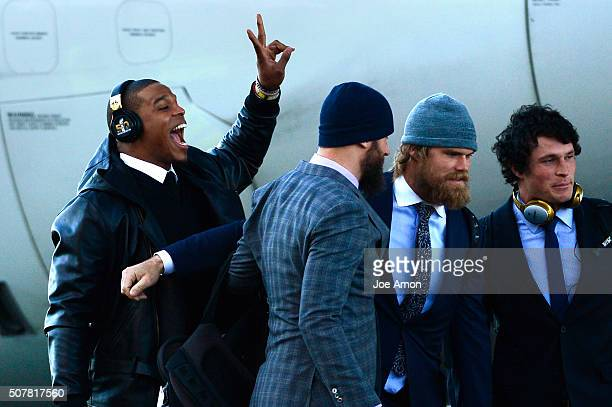 Carolina Panthers quarterback Cam Newton photo bombs his team mates as they arrive in California with at the Mineta San Jose International Airport...