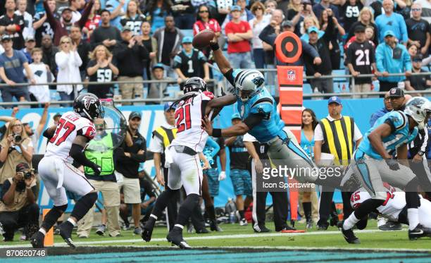 Carolina Panthers quarterback Cam Newton reaches for a touchdown during 1st half of the Carolina Panthers versus the Atlanta Falcons on November 5 at...