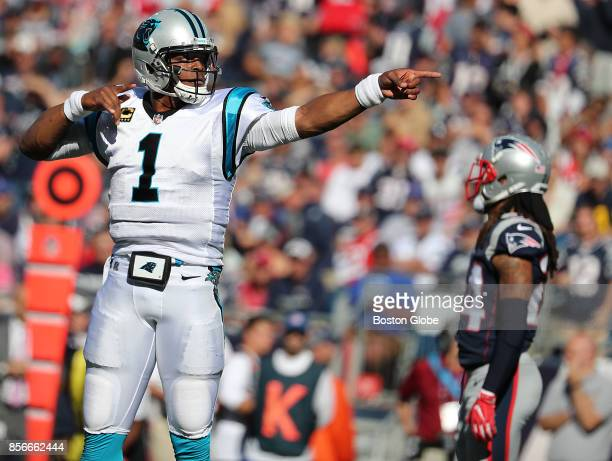 Carolina Panthers quarterback Cam Newton reacts after 13yard run picking up the first down against the New England Patriots during third quarter...