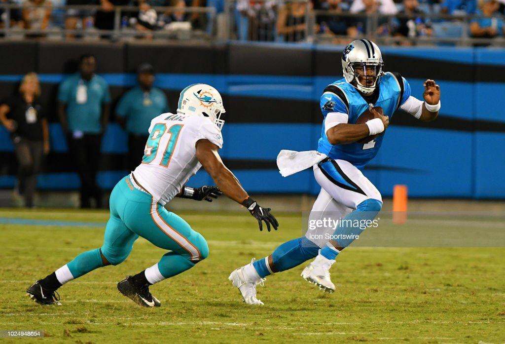 Carolina Panthers quarterback Cam Newton scrambles as ...