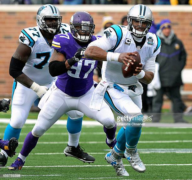 Carolina Panthers quarterback Cam Newton scrambles for yardage as Minnesota Vikings defensive end Everson Griffen gives chase during second quarter...