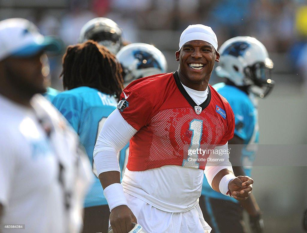 Carolina Panthers quarterback Cam Newton smiles as he and ...