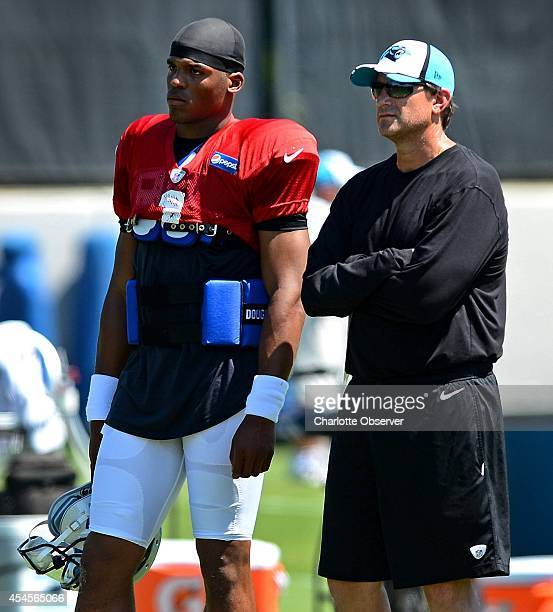 Carolina Panthers quarterback Cam Newton stands with offensive coordinator Mike Shula during practice on Wednesday Sept 3 2014 Newton did not...