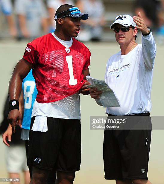 Carolina Panthers rookie quarterback Cam Newton talks with quarterbacks coach Mike Shula during practice at Gibbs Stadium on the campus of Wofford...