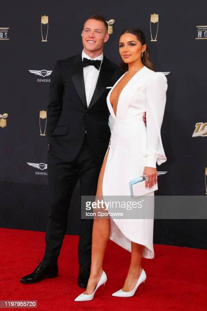 Carolina Panthers running back Christian McCaffrey and Olivia Culpo pose on the Red Carpet poses prior to the NFL Honors on February 1 2020 at the...