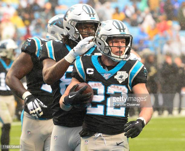 Carolina Panthers running back Christian McCaffrey celebrates after scoring a touchdown against the New Orleans Saints on December 29 at Bank of...