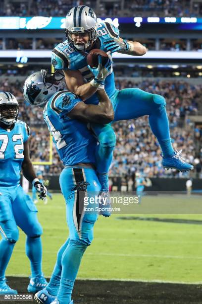Carolina Panthers running back Christian McCaffrey celebrates with tight end Ed Dickson during second half action between the Carolina Panthers and...