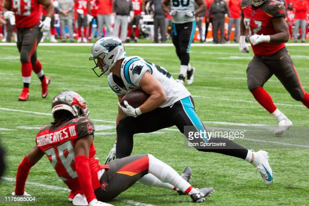 Carolina Panthers Running Back Christian McCaffrey escapes a tackle on his way to the end zone for a touchdown during the game between the Carolina...
