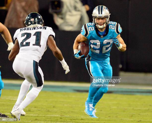 Carolina Panthers running back Christian McCaffrey heads upfield against Philadelphia Eagles defensive back Patrick Robinson in the first half at...