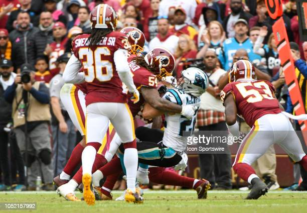 Carolina Panthers running back Christian McCaffrey his hit by Washington Redskins linebacker Mason Foster in the second half on October 14 at FedEx...