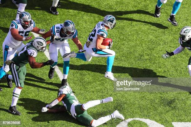 Carolina Panthers running back Christian McCaffrey hurdles New York Jets strong safety Jamal Adams during the first quarter of the National Football...