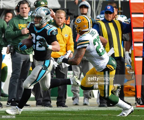Carolina Panthers running back Christian McCaffrey left rushes for yardage as Green Bay Packers safety Josh Jones right gives chase during first...