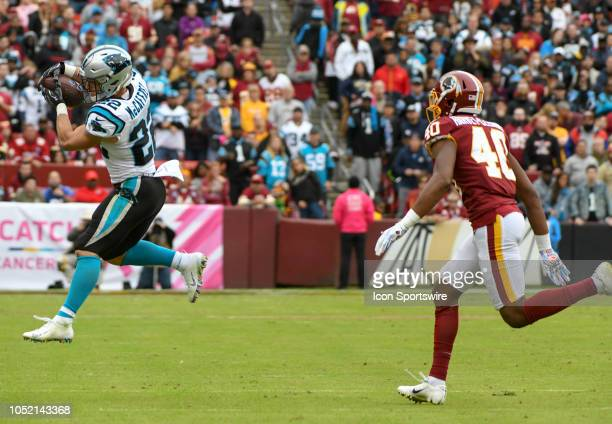 Carolina Panthers running back Christian McCaffrey makes a fourth quarter reception against Washington Redskins linebacker Josh HarveyClemons on...