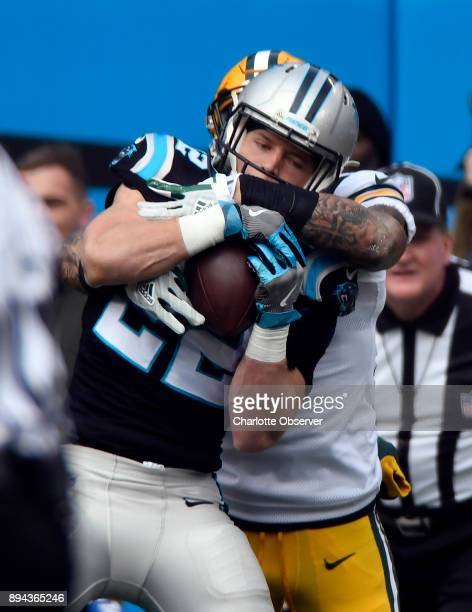 Carolina Panthers running back Christian McCaffrey makes a reception in front of Green Bay Packers strong safety Josh Jones in the first half on...