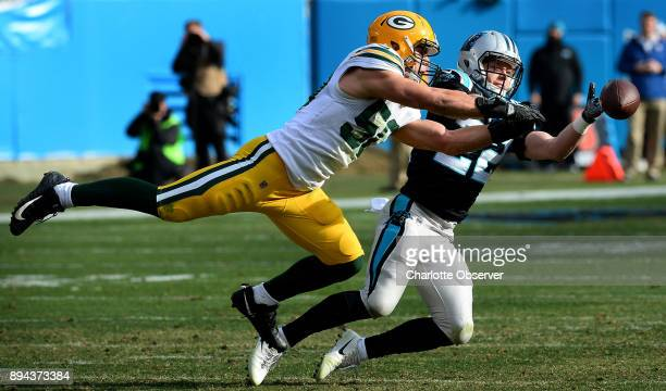 Carolina Panthers running back Christian McCaffrey right reaches out in an attempt to catch a pass as Green Bay Packers linebacker Blake Martinez...