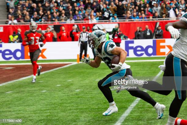 Carolina Panthers Running Back Christian McCaffrey runs for the end zone to score during the game between the Carolina Panthers and the Tampa Bay...