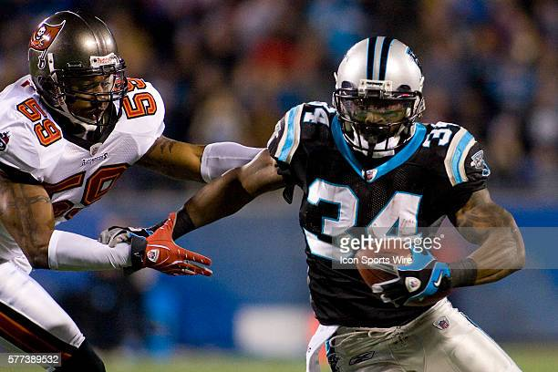 Carolina Panthers running back DeAngelo Williams runs against Tampa Bay Buccaneers linebacker Cato June during an NFL football game at Bank of...
