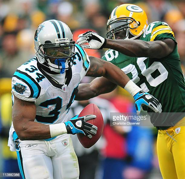 Carolina Panthers running back DeAngelo Williams scores the team's first touchdown during first quarter action against Green Bay Packers safety...