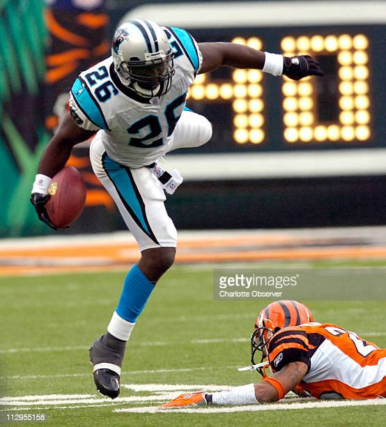 Carolina Panthers running back DeShaun Foster gets tripped up by Cincinnati Bengals defensive back Keiwan Ratliff during the third quarter The...