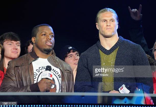 Carolina Panthers Running Back Jonathan Stewart and Green Bay Packers Linebacker Clay Matthews III speaks onstage during VH1's Super Bowl Fan Jam at...
