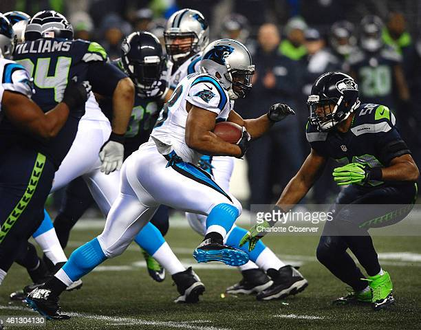 Carolina Panthers running back Jonathan Stewart fights for yardage as Seattle Seahawks linebacker KJ Wright looks to make the stop during the first...