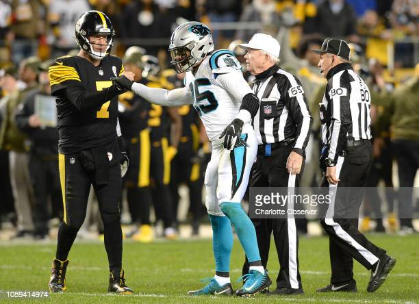 Carolina Panthers safety Eric Reid bumps fists with Pittsburgh Steelers quarterback Ben Roethlisberger after Reid was removed from the game after...