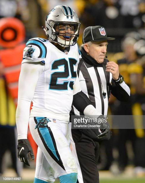 Carolina Panthers safety Eric Reid is led to the team's sideline by an official after he made a hit on Pittsburgh Steelers quarterback Ben...
