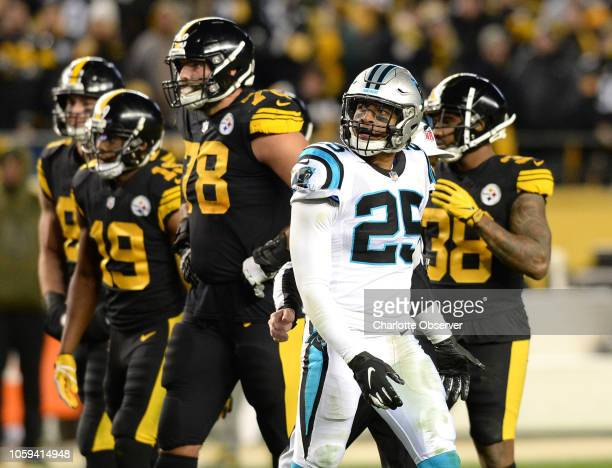 Carolina Panthers safety Eric Reid looks at the video board after being removed from the game for unsportsmanlike conduct on a tackle of Pittsburgh...