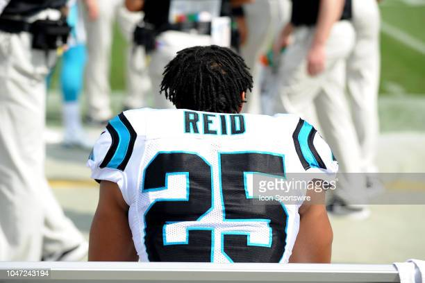 Carolina Panthers safety Eric Reid sits on the bench just after taking a knee during the National Anthem prior to the NFL game between the New York...