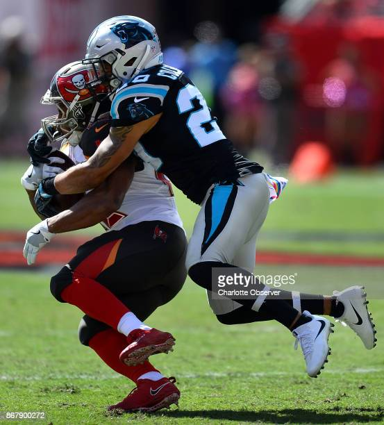 Carolina Panthers safety Kurt Coleman right makes the tackle on Tampa Bay Buccaneers running back Doug Martin left during first quarter action on...
