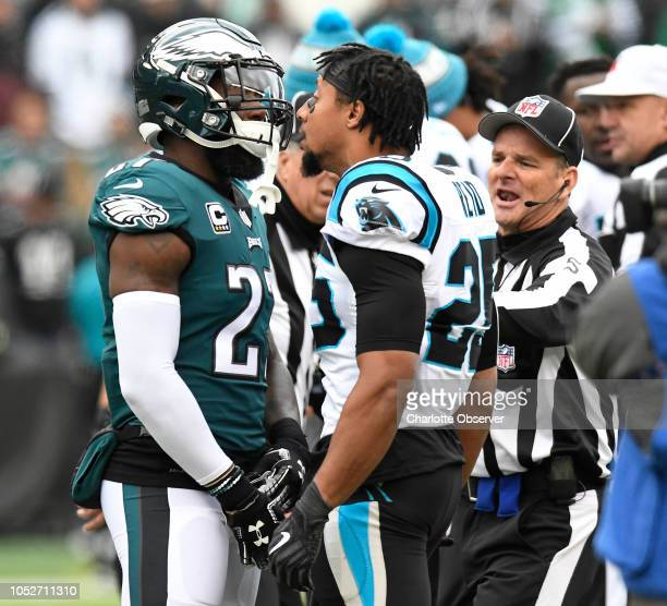 Carolina Panthers strong safety Eric Reid has words for Philadelphia Eagles strong safety Malcolm Jenkins prior to the start of the game on Sunday...