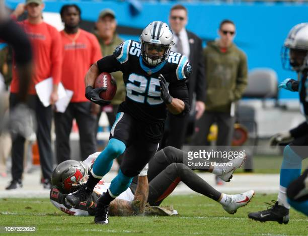 Carolina Panthers strong safety Eric Reid heads past Tampa Bay Buccaneers wide receiver Mike Evans after intercepting a pass in the first half on...