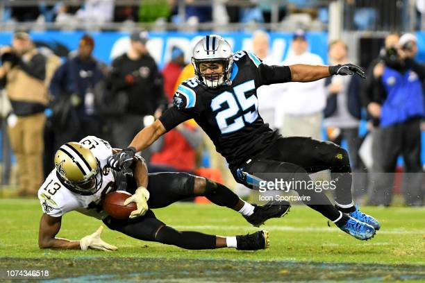 Carolina Panthers strong safety Eric Reid tackles New Orleans Saints wide receiver Michael Thomas with a solid hit just after he makes a catch in...