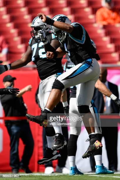 Carolina Panthers tackle Taylor Moton and Carolina Panthers quarterback Cam Newton prior to an NFL football game between the Carolina Panthers and...