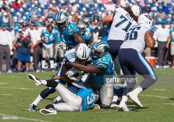 Carolina Panthers tackle Taylor Moton tackles Tennessee Titans running back Akeem Judd during the preseason NFL game between the Tennessee Titans and...