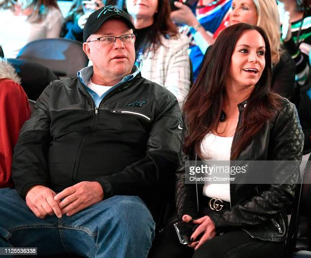 Carolina Panthers team owner David Tepper left sits courtside prior to the NBA AllStar Game at Spectrum Center in Charlotte NC on Sunday February 17...