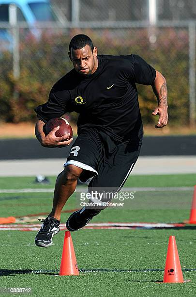 Carolina Panthers tight end Dante Rosario leaps over a cone during a timed drill while working out with Jeremy Boone of Athletes By Design at Ardrey...