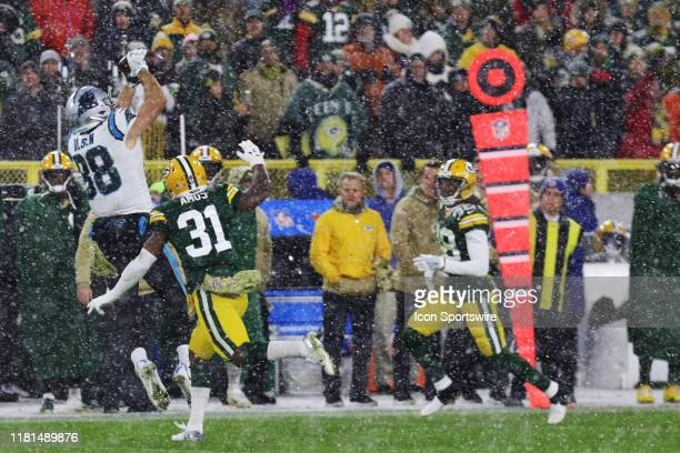 Carolina Panthers tight end Greg Olsen goes up over Green Bay Packers strong safety Adrian Amos to make a catch during game between the Green Bay...